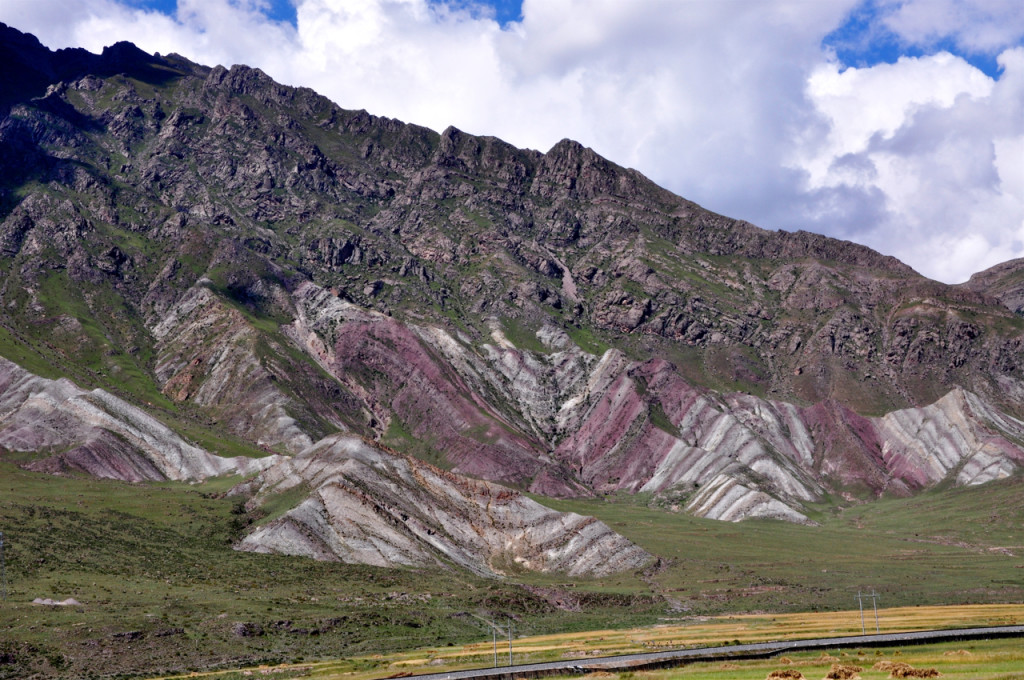 This spectacular c. 70 Ma regional angular unconformity in southern Tibet raises questions about the pre-collisional history of the plateau. Telegraph pole for scale.