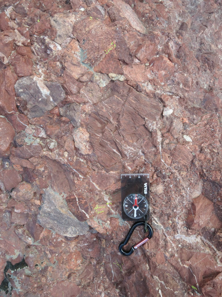 Conglomerate! As a True Geologist, I have to show an image of rocks with a compass on.