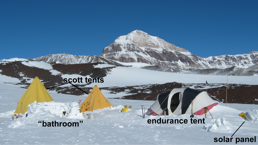 "Figure 5. A typical field camp consists of several scott tents and an endurance tent. Full pee jugs surround our ""bathroom"" (yes, we take out all waste). We learned the hard way that an overfilled jug would spill as it froze and expanded."