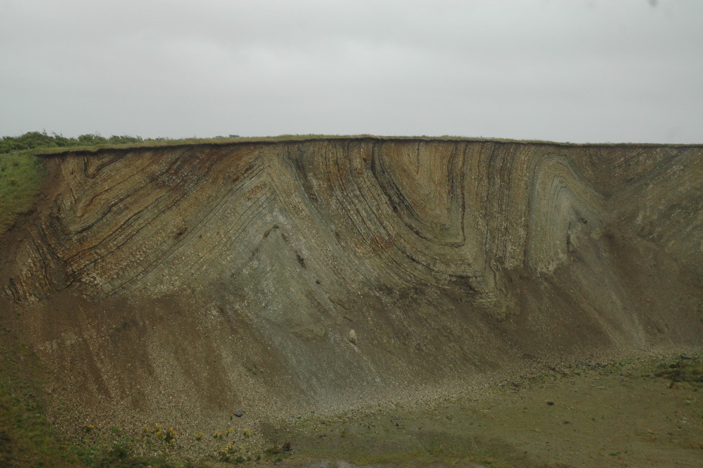 The Moler with interbedded light grey diatomites and darker volcanic ash layers. The whole sediment pile has been sharply folded by glacial push.