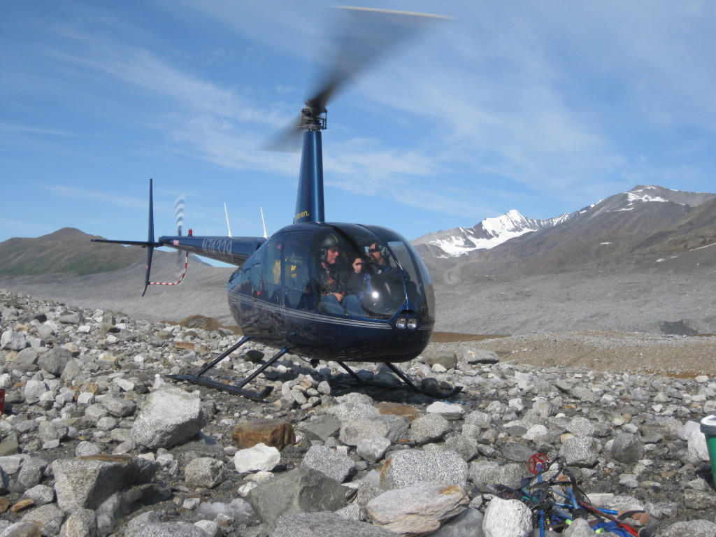 Helicopter take-off from on top of the ice-cored moraine at our 1st camp with Dr. Paul Fitzgerald and Dr. Jeff Benowitz headed to the Susitna Glacier.