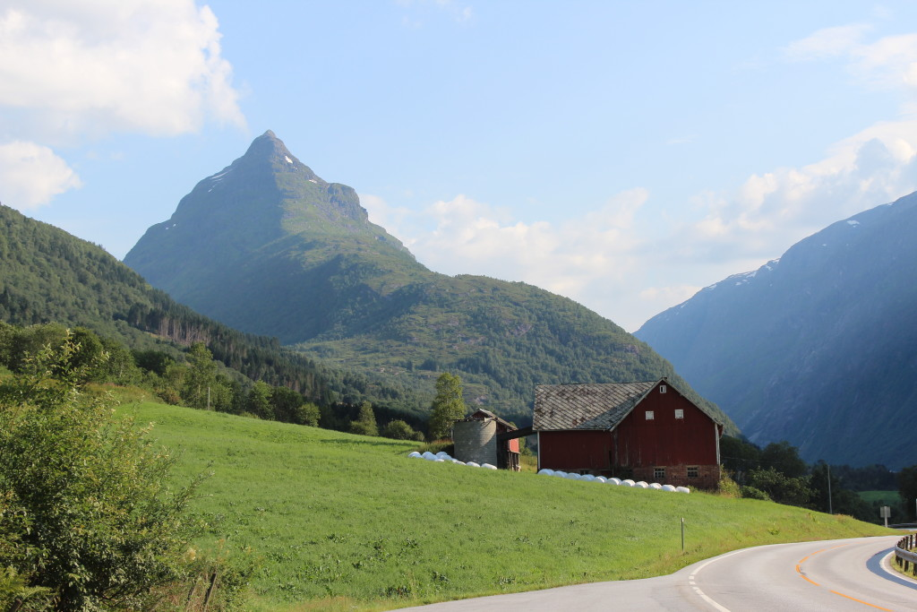 Barnhouse on the side of glacially sculpted peaks and valleys.