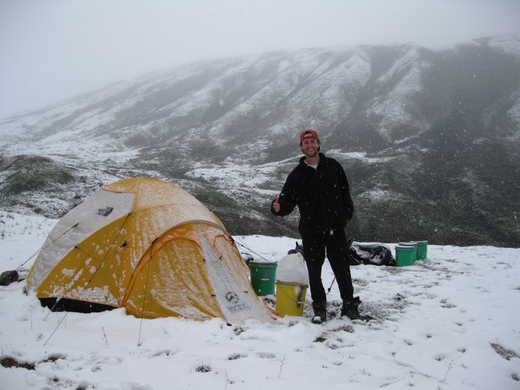 Me outside of our tent, snowed in at our second camp along the Susitna Glacier valley.