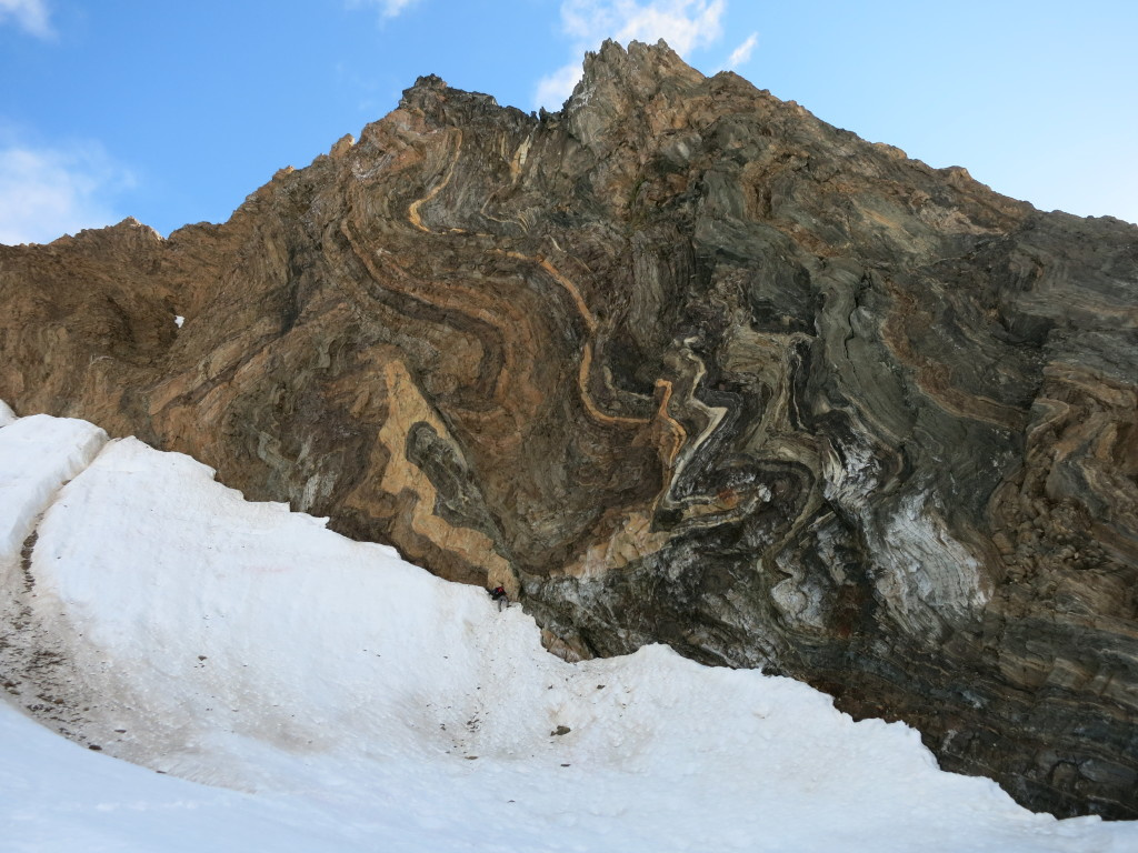 Strongly folded and faulted rocks of the middle-grade metamorphic unit on Prins Karls Forland. Note Maciek Manecki (175cm tall) at the bottom of the outcrop