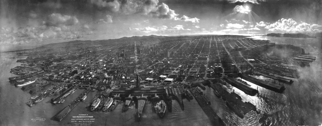 San Francisco lies in ruins on May 28, 1906, about six weeks after the 1906 San Francisco earthquake and fire. It was taken from a camera suspended on a kite, perhaps 1,000 feet above the city. It is one of the most well-known photographs of George R. Lawrence (see biography for more information about the technique used). The tower of the Ferry Building can be seen at the bay end of Market Street, which can be clearly seen all the way to the foothills of Twin Peaks. The water in the foreground is San Francisco Bay, with the Golden Gate to the right, rear. Note the absence of the Golden Gate Bridge and the San Francisco-Oakland Bay Bridge, which had yet to be constructed.