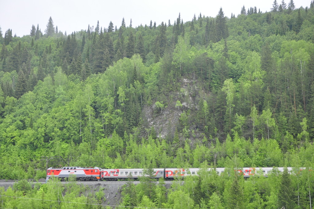 The Transsiberian Railway, passing by the Koronka reef on the other side of the Sylva river.