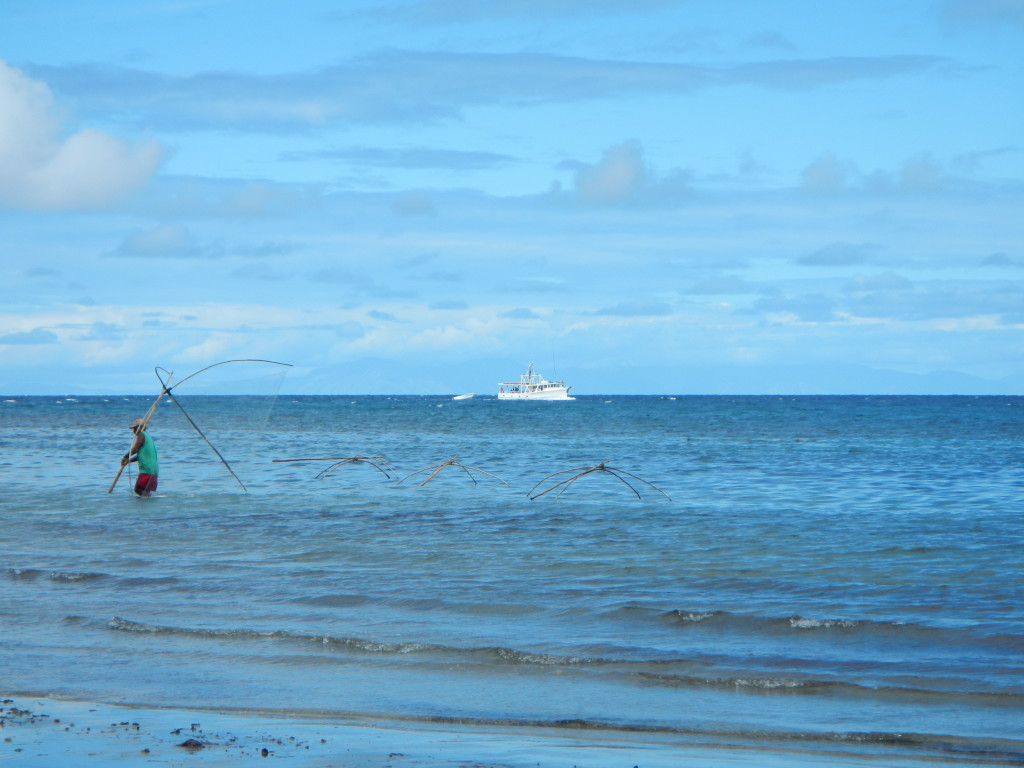 Figure 12. Arrival of the Sara Lee with a local fisherman maneuvering his nets.