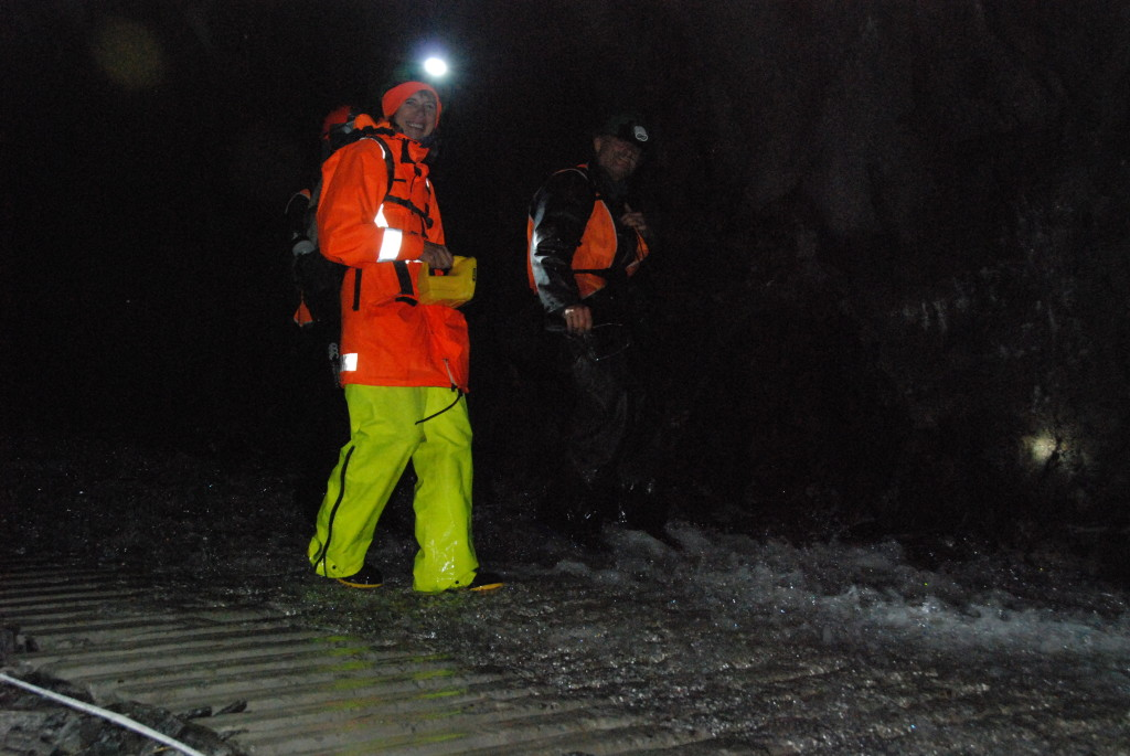 Tim and Susan surveying the Amethyst Hydro Tunnel in wet conditions.
