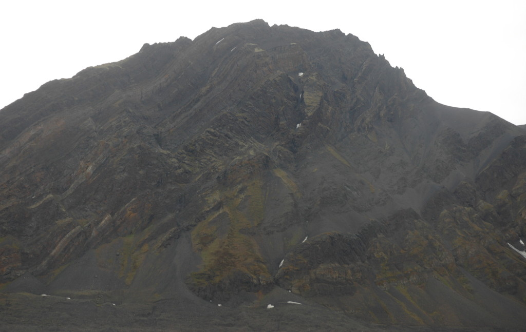 The Mediumfjellet thrust, on the North side of Isfjorden, Svalbard: Permian evaporite, Triassic shale and sand, intruded by a Cretaceous dolerite, and then thrusted up by the compression from Greenland.