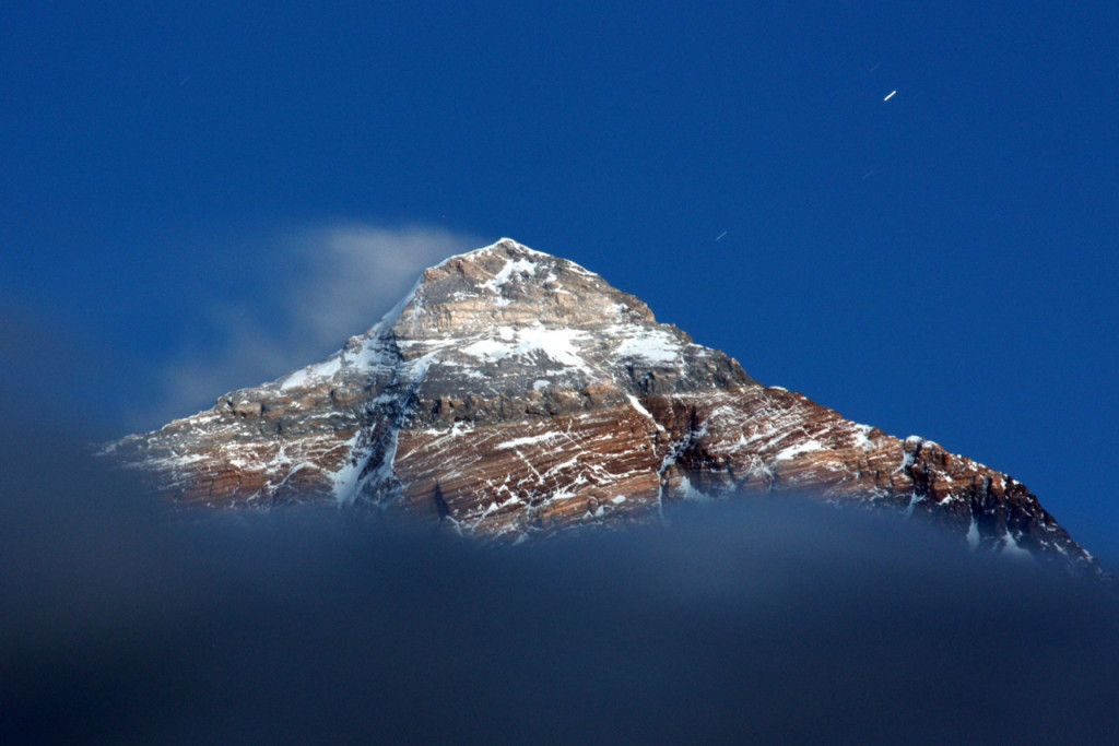 A photo of the summit of Qoomalangma (Everest) illuminated by moonlight taken by the author during field work in 2011.