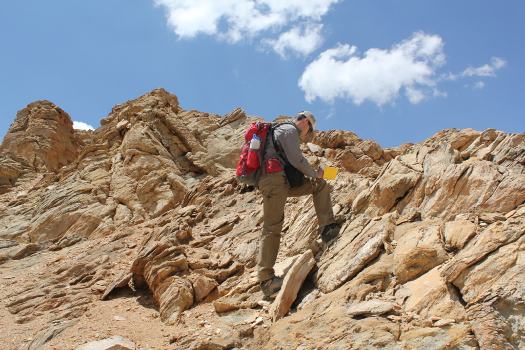 Andrew Laskowski conducting field work in the Lopu Range, photo by Dr. Paul Kapp.