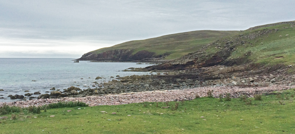 Fig. 1 – The start of the walk from near the graveyard south of Stoer. The Stac Fada Member forms the promontory of rock that extends to the sea stack just visible centre left.