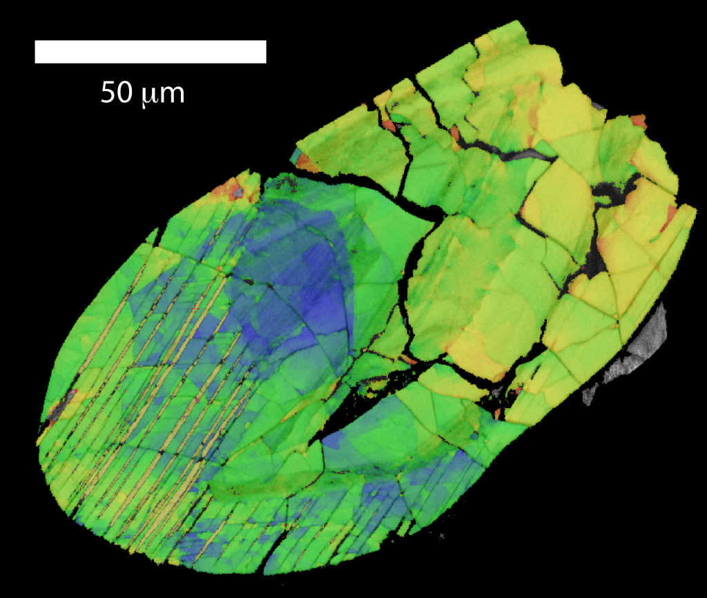 Fig. 5 – False-coloured image of a zircon grain containing thin lamellae of reidite (bottom left).