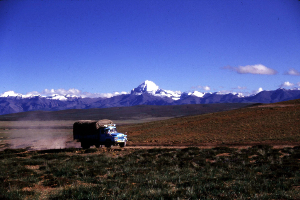 Doing geology in Tibet requires hauling all of your gear in a huge truck called a Dong Feng. That is Mount Kailas in the background. How could you not be drawn to this? (Photo by Paul Kapp).