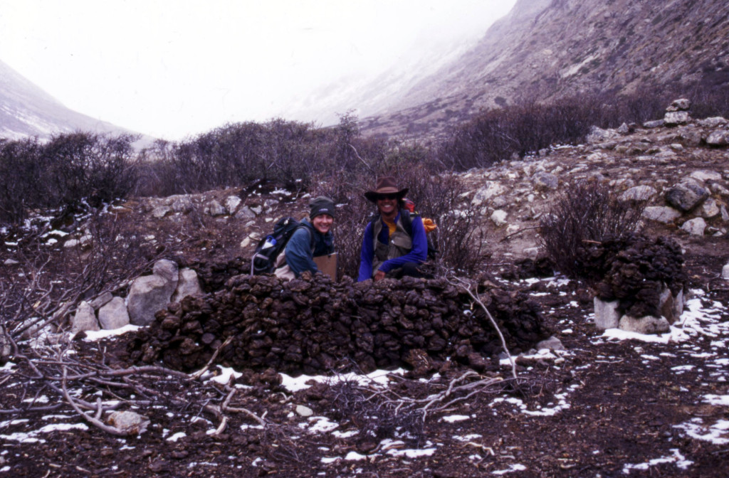 Me and Mike Taylor crouching inside a small shelter made of yak dung in the Goring La valley, Nyainqentanglha range, Tibet.