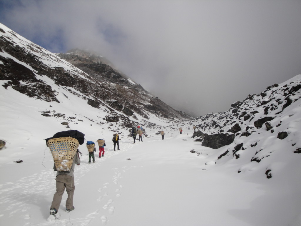 Photo 4. The crew setting out from camp in the morning heading over Gyago La in the Numbur region of east-central Nepal. (Photo credit – K.Larson)