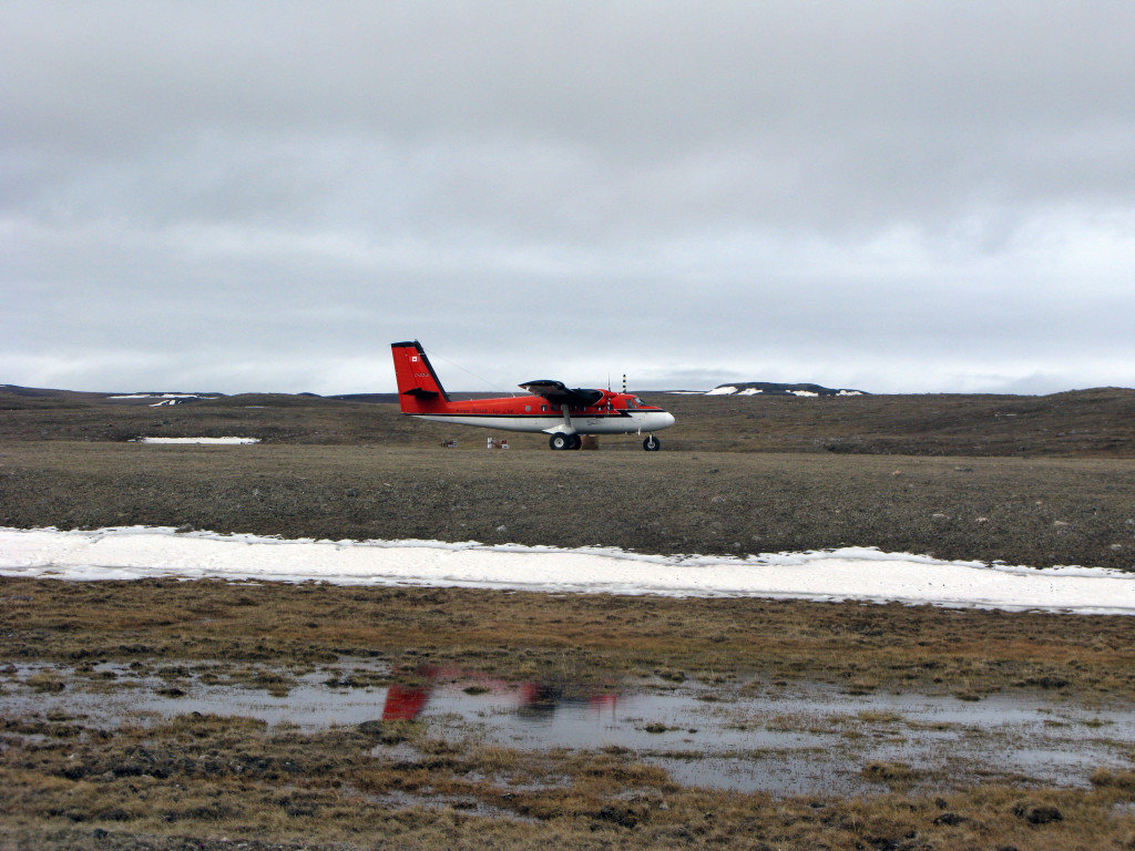 Twin Otter landing on the runway (i.e., flattest section of tundra) at basecamp.