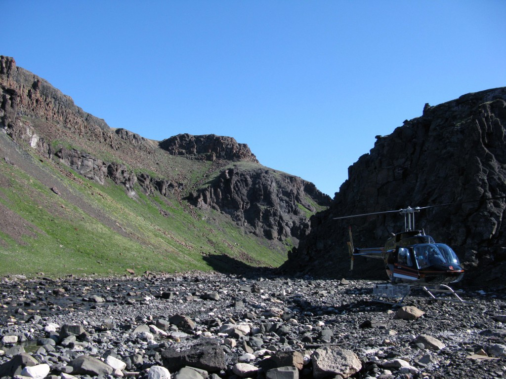 River cut through the Natkusiak Formation. Visible is one of the volcaniclastic units capped by thicker lavas.