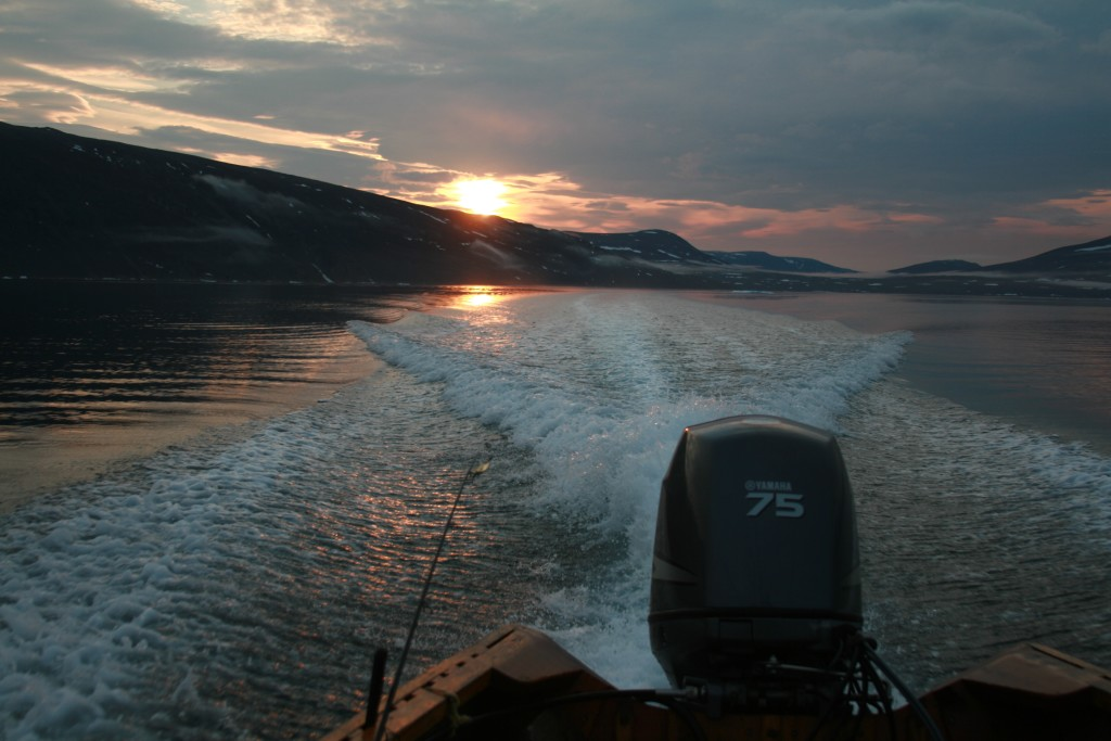An Arctic sunset from the open ocean canoe as we make our way to basecamp.