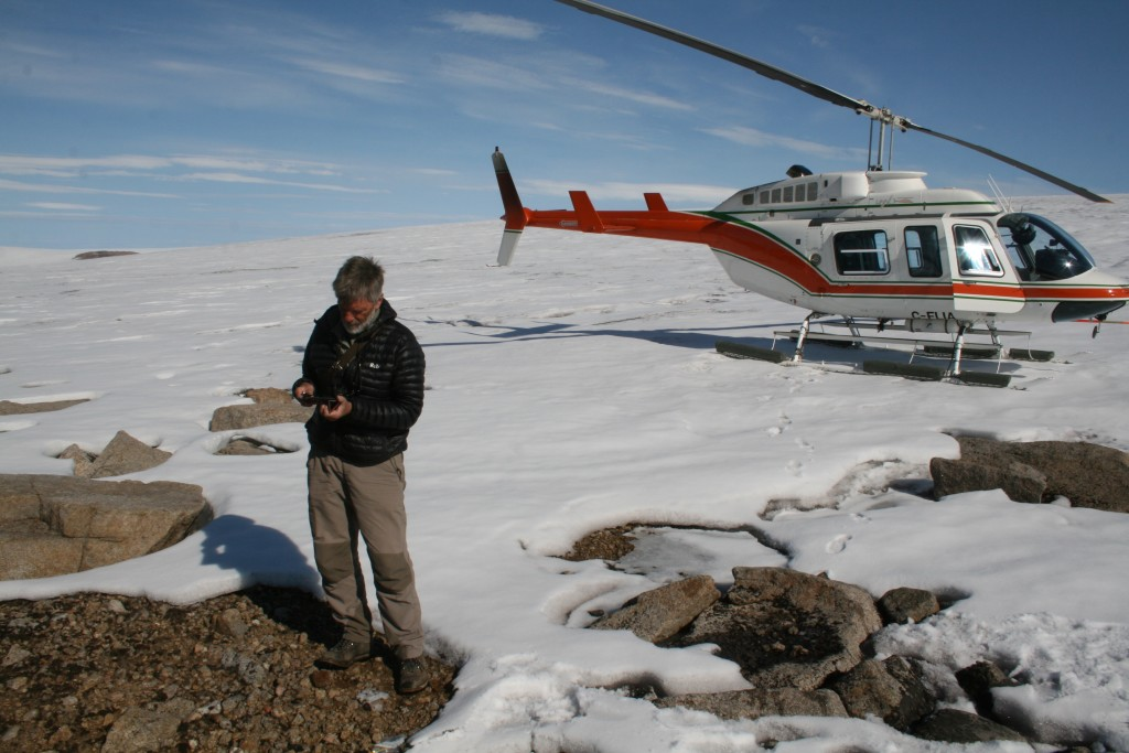 Dr. Gifford Miller making the long trek from the helicopter to the ice edge sampling dead moss emerging from the retreating ice edge.