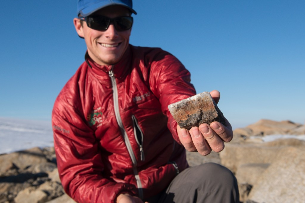 The author with a sampled piece of pure quartz from exposed bedrock, which he hopes contains all the answers to his PhD.