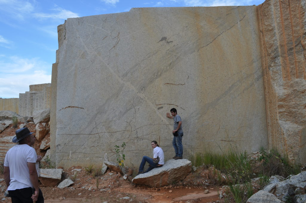 Figure 4 - Abandoned mining site showing the structures and features of the granitoid. From left to right are Prof. Gary Stevens, Prof. Pedrosa-Soares, me, and my main advisor, Prof. Cristiano Lana.