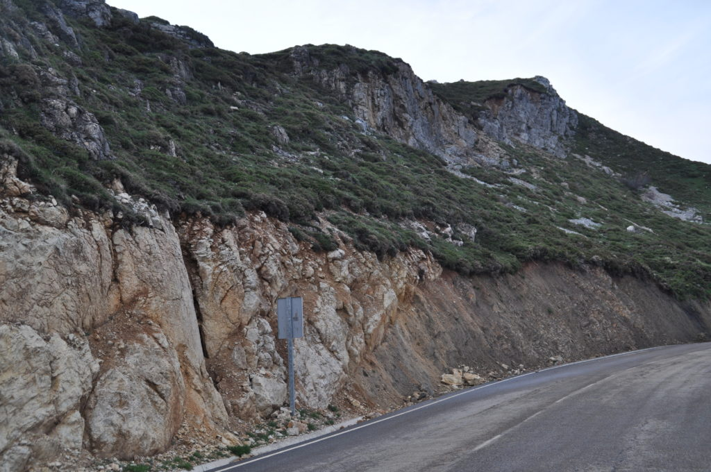Cambrian (white limestone) over Carboniferous (grey sandstone). Nice thrust, just there, in the middle of the road.