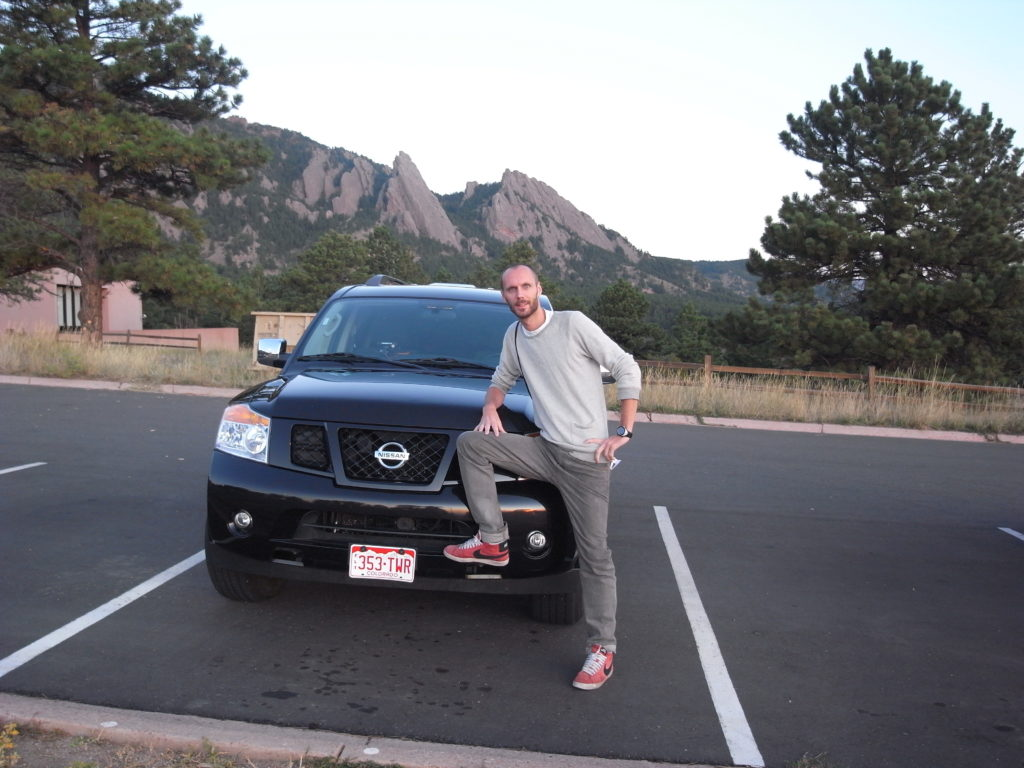 Me in front of SUV and more importantly; the Flatirons!