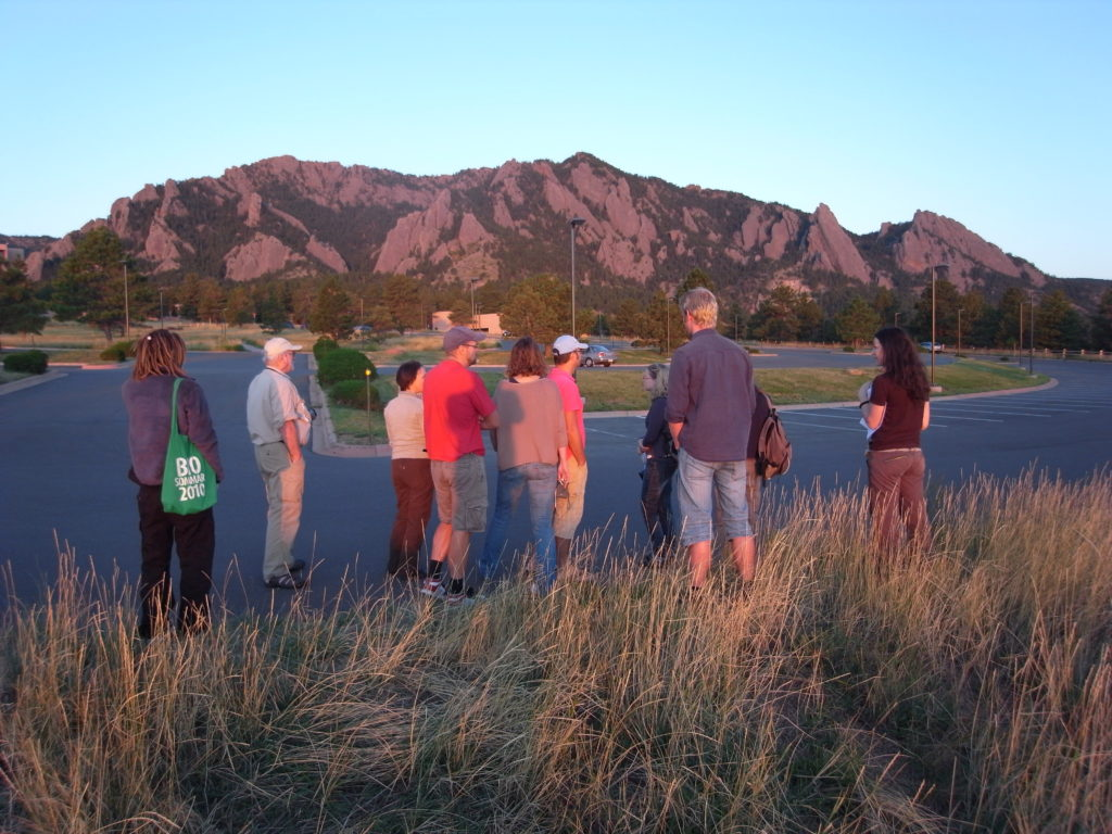 All of us enjoying the sunset at the Flatirons