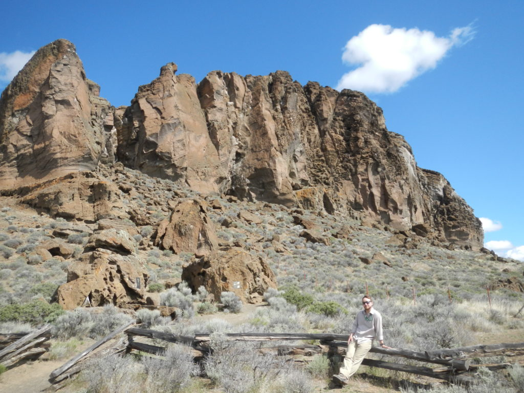 Matthew Nikitczuk in front of the Fort Rock monument. Photo by Nevena Novakovic.