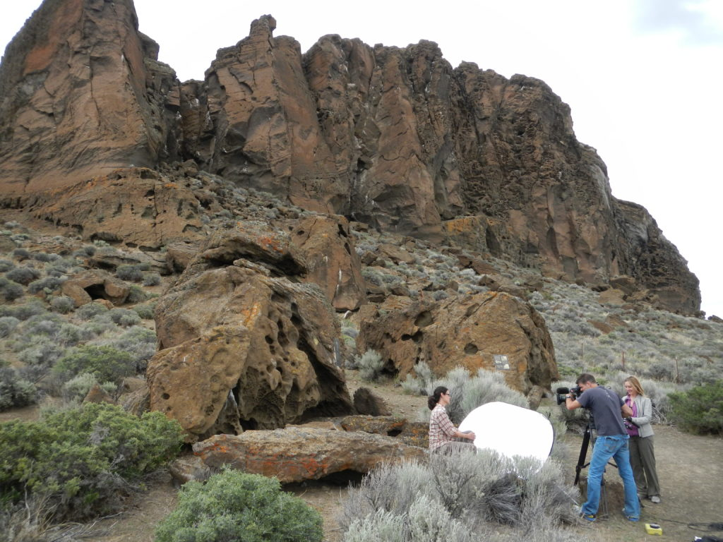Dr. Mariek Schmidt being interviewed by the Discovery Channel in front of the Fort Rock tuff ring. Photo by Matthew Nikitczuk.