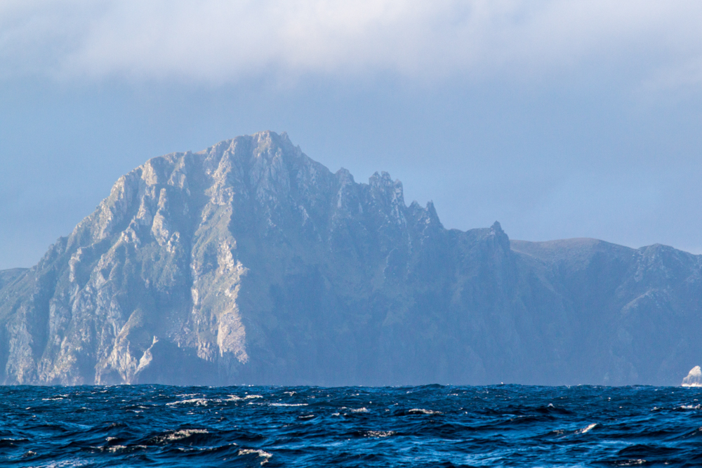 The towering silhouette of Cape Horn Island. The sampled lake is right behind the cliff (©Thomas Ronge).